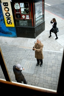 People take photographs in the ally between the Vesuvio Cafe and City Lights Books in San Francisco's North Beach Neighborhood, Saturday, November 20, 2010. The Vesuvio Cafe and the surrounding neighborhood is a famous hang out of many of San Francisco's past literary greats. Thor Swift For The New York Times